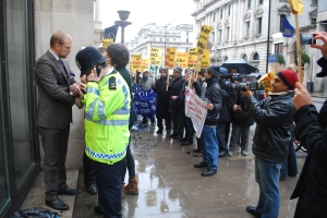 2012-12-21 12.08.18 Activist dressed as GCM executives is arrested as demonstration rages - demo pic by Samarandra Das