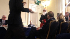 protesters dressed Santa Claus present GCM board with coal