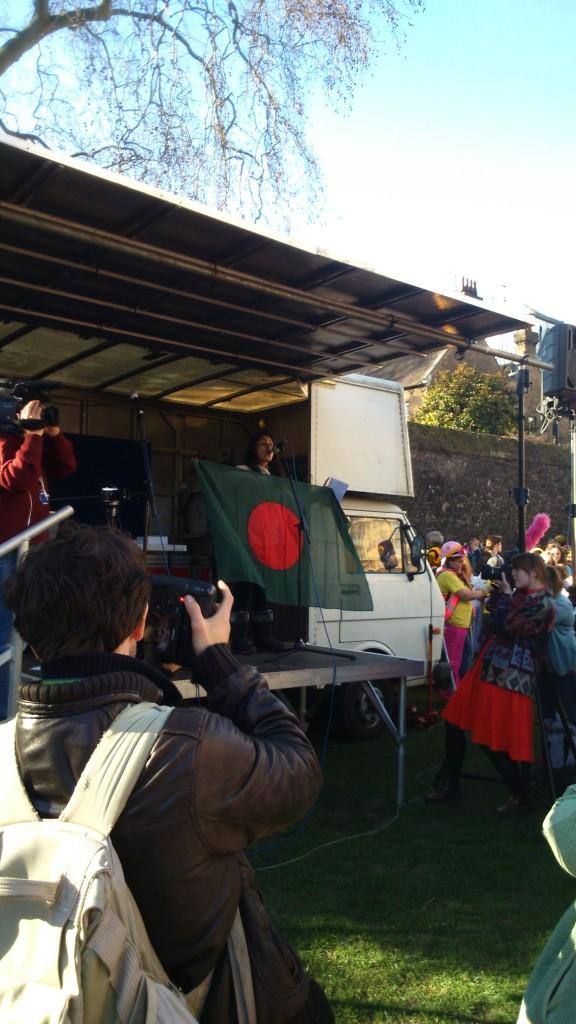 Rumana Hashem of Bangladesh National Committee and Phulbari Solidarity Group waves Bangladeshi flag to cheer up the protesters. Photo credit: Paul  V. Dudman