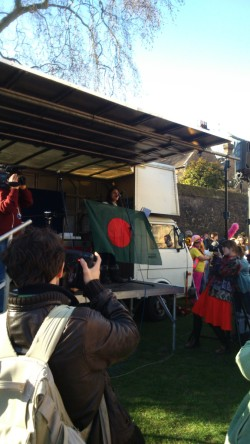 Rumana Hashem of Bangladesh National Committee and Phulbari Solidarity Group waves Bangladeshi flag to cheer up the protesters. Photo credit: Paul  V. Dudman