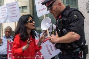 Arguments with Police who prohibited Rumana Hashem to display the banner for the victims on the pavement Copyright Peter Marshall