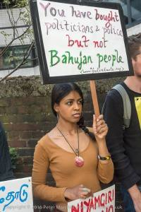 Foil Vedanta demo on 5 August 2016.  A Protester from affected community holds a placard. Photocredit: Peter Marshall