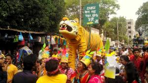 green cultural activists at samageet brought in a a procession with a royal bengal tiget on Bangla New year 2016