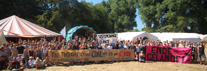 A thousand of people at lunch of Rhineland Klima Camp in resistance from Germany, around Europe and beyond stood in Solidarity with Phulbari protesters on the tenth anniversary of Phulbari outburst on 26 August 2016. Photo credit: Klima Camp Solidarity